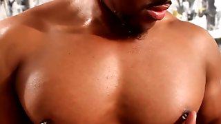 Muscular ballpierced black masturbating
