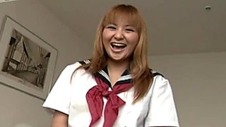 Chubby face Yui Natsume takes off her panties and wanks on a bed