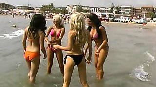 4 Stunning Glamour Babes Tanning On The Beach